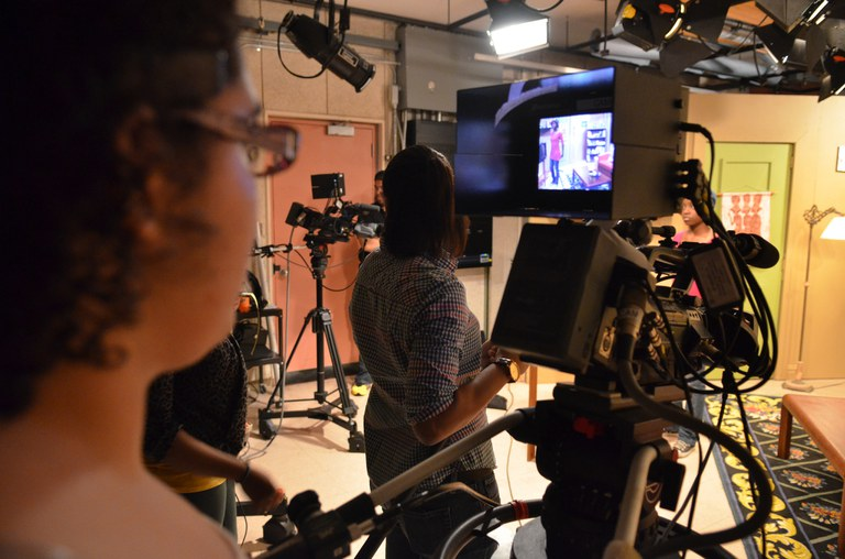 A student uses a camera at the York College Television Studio during a shoot.