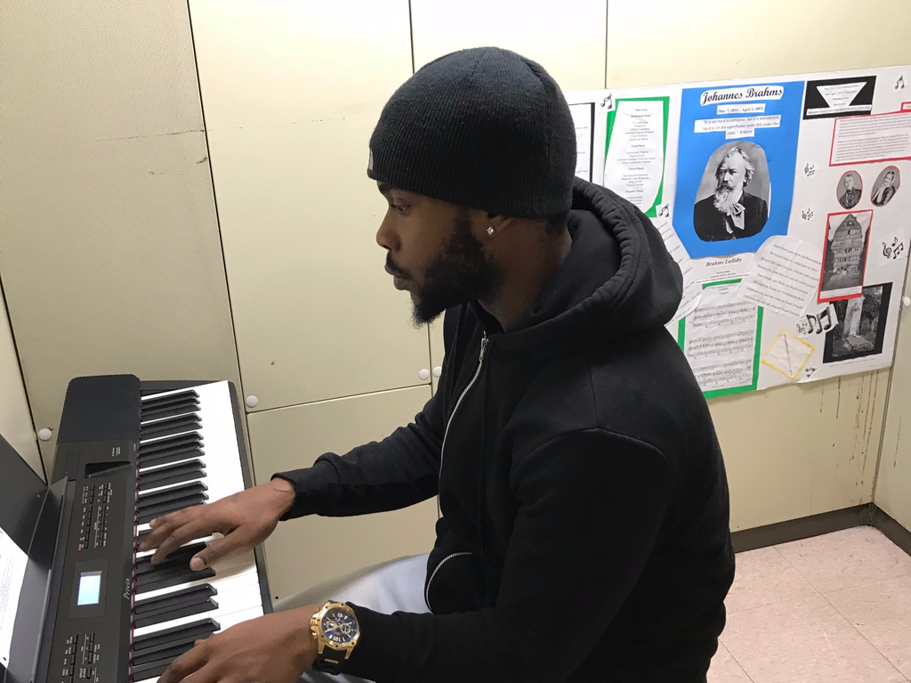 York College music student practices on the digital pianos in LL03.