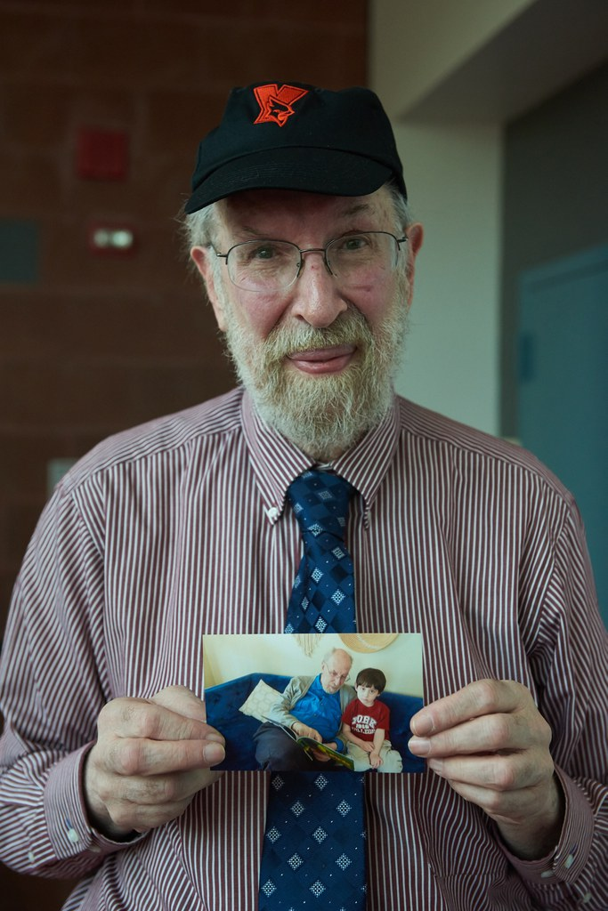 Professor Malkevitch with photo of grandson wearing York t-shirt