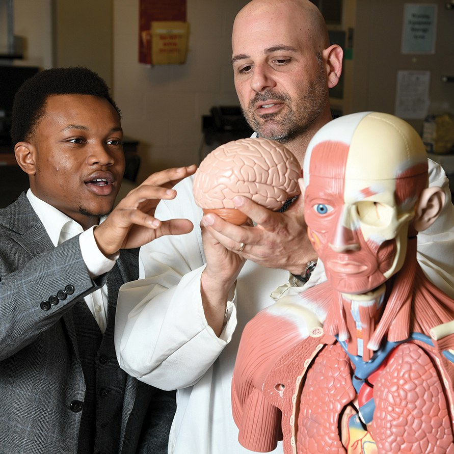 Prof. Andrews and Student Holding Brain