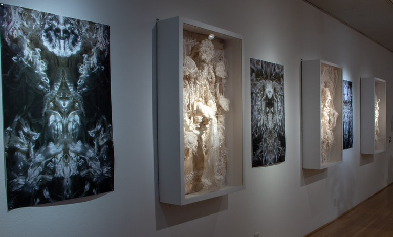Multiple art pieces by Pablo Garcia Lopez in the York College gallery space including sculptures, painting and on-screen