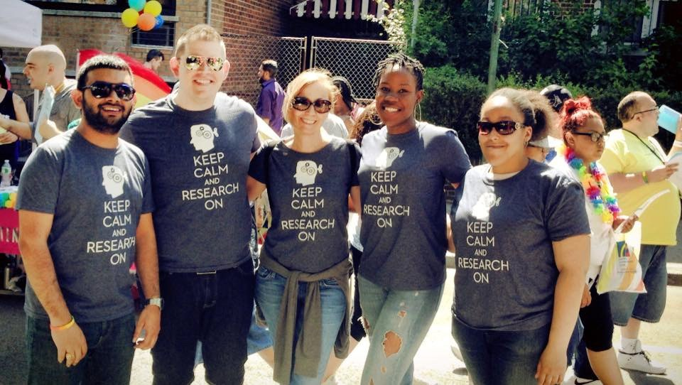"Five researchers wear ""Keep calm and research on"" shirts"