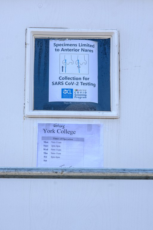 door with SARS Cov-2 Testing sign