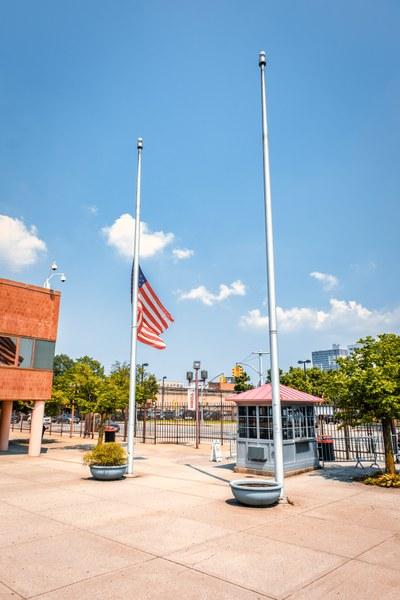 Campus entrance, US Flag half mass