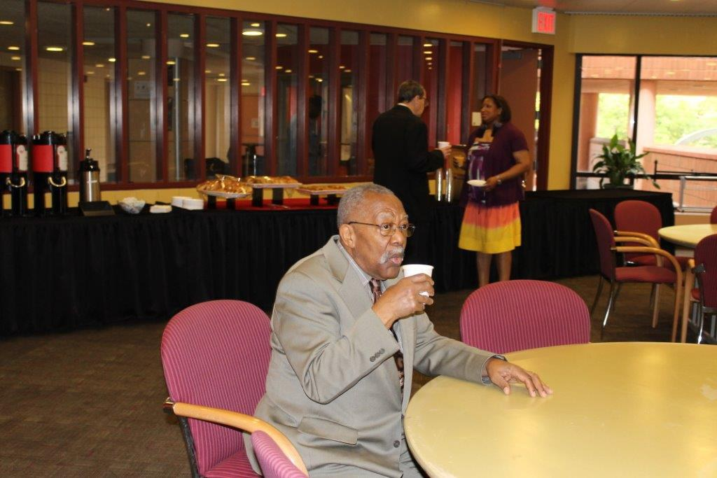 Alum, Victor Richards enjoying a cup of coffee