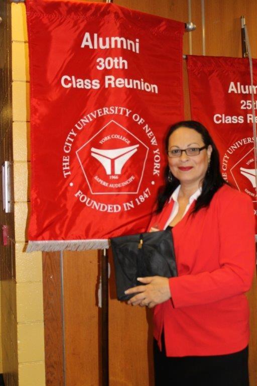 Brunilda Almodovar with her Alumni Class Reunion banner
