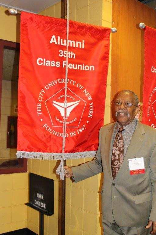 Victor Richards carrying his 35th Class Reunion Class banner