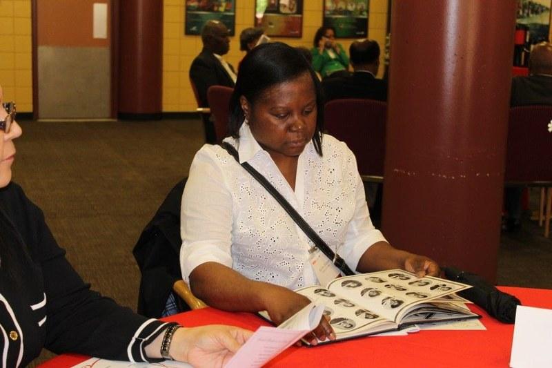 Alum looking through her class yearbook