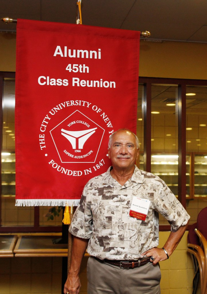 Alum posing with the 45th class Reunion banner