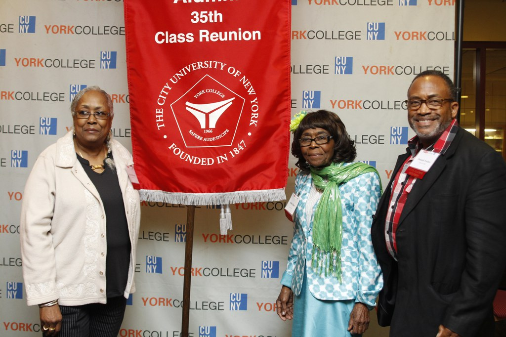 Alums with 35th class reunion banner