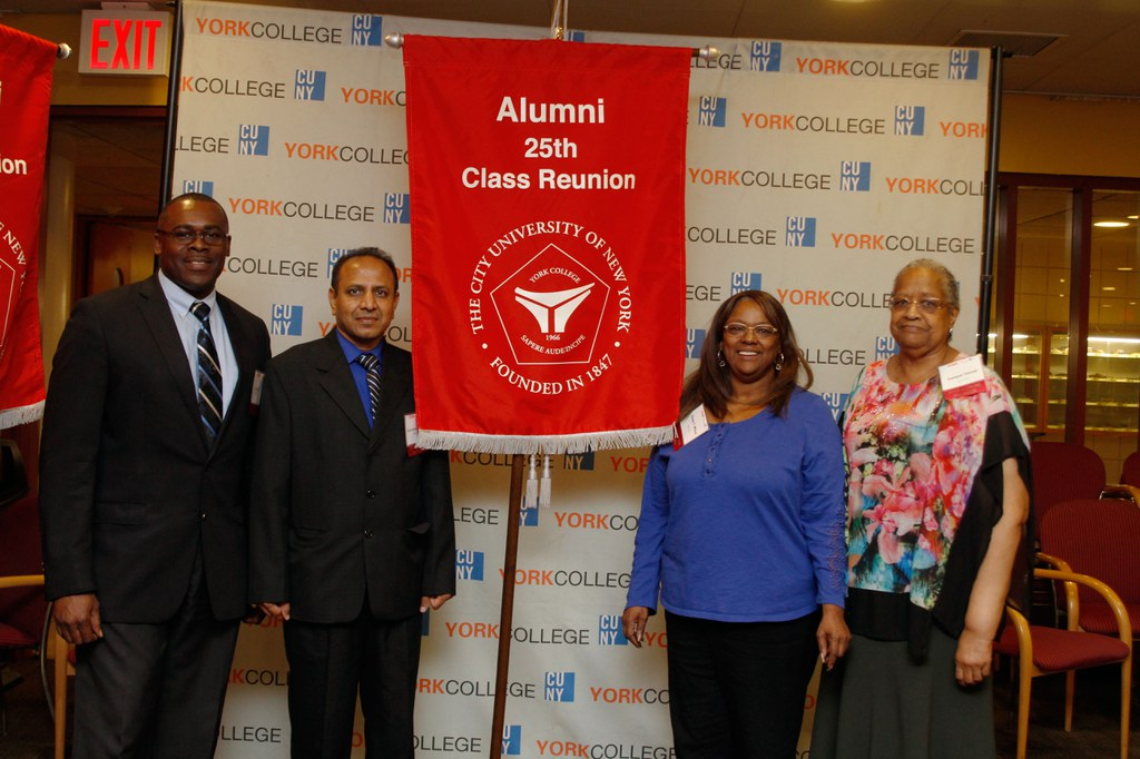 Alums posing with their 25th class Reunion banner