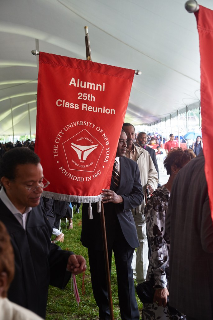 Alums with 25th Class Reunion banner