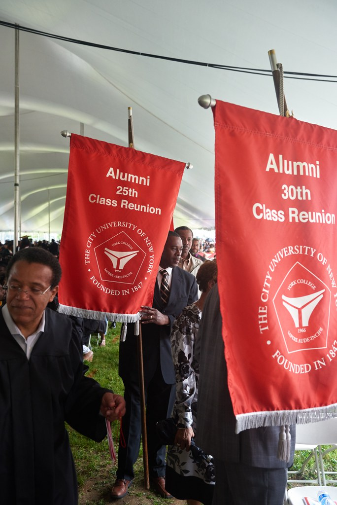 Alums carrying their Class banner