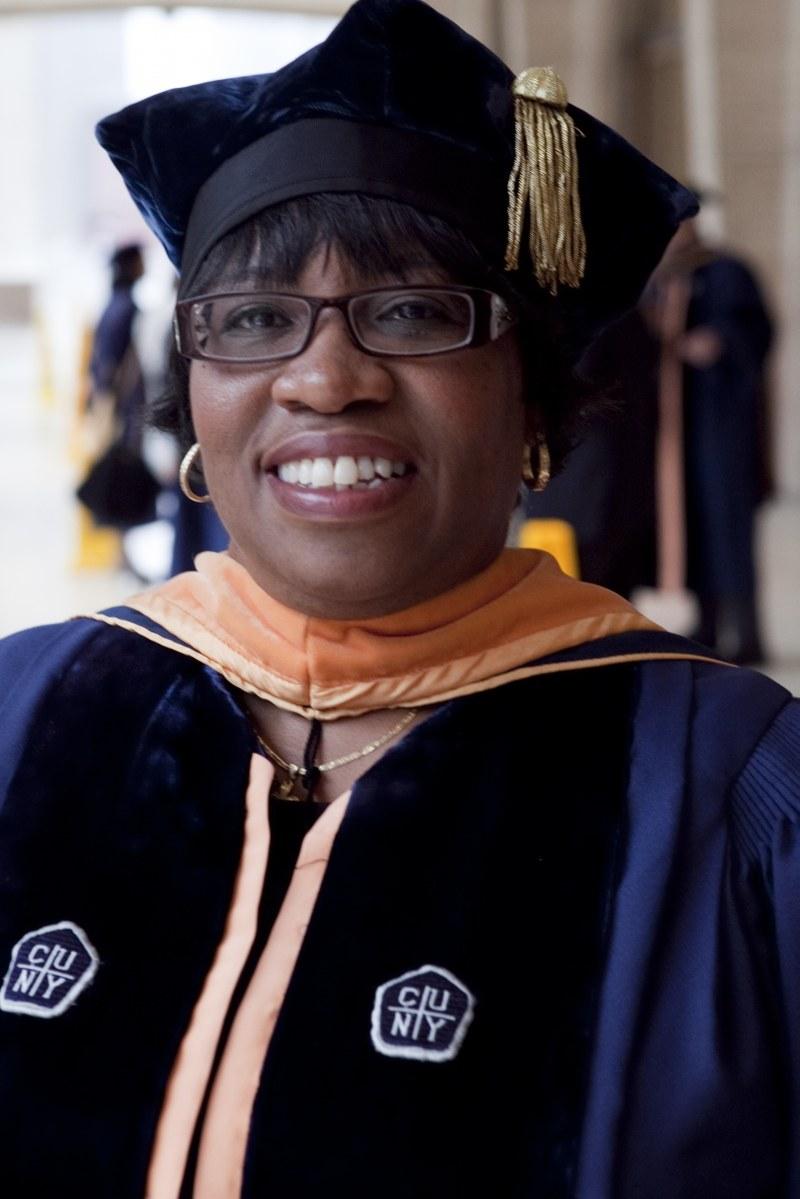 Dr. Taylor-Haslip in her PHD Graduation Regelia