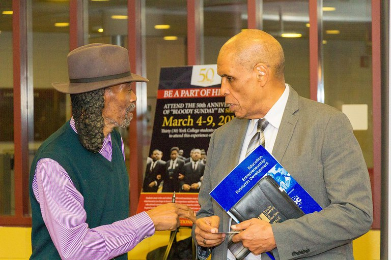 On the right we have NYSBDC's at York College Regional Director Mr. Harry Wells connecting with clients and hearing out suggestions.