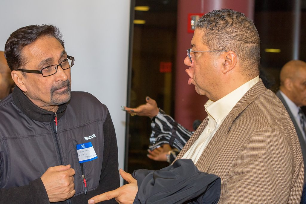 Brian Ansari (On the right) discusses with a member of the crowd.