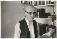 Moshe Bassin, York College. Black and white photo of a man with glasses.