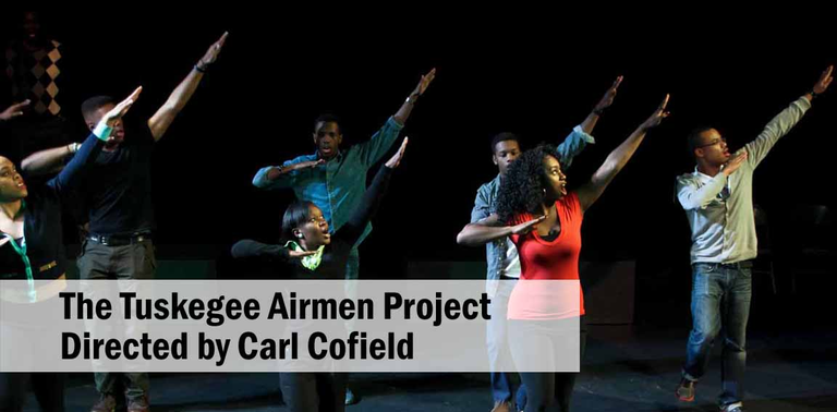 Cast members in dance pose with out reached left arms pointing to sky.