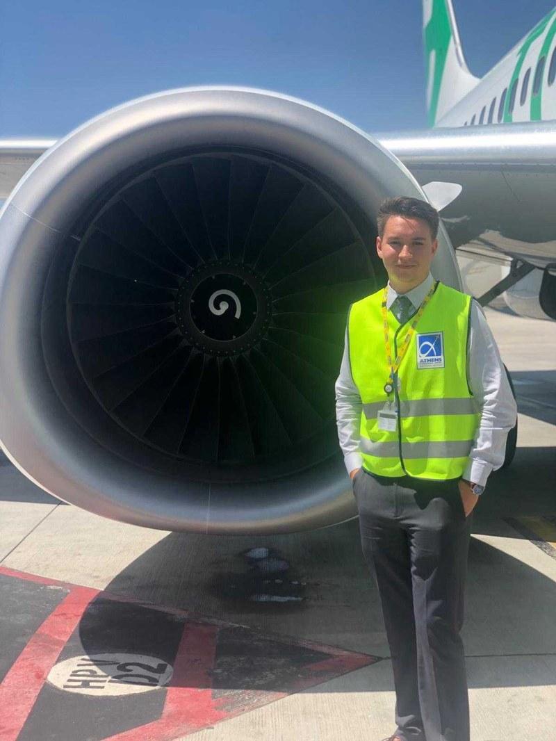 Vitaliy Matsko stands in front of airplane