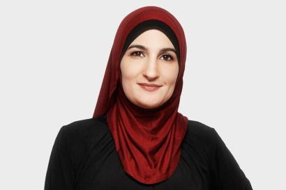 """(born 1980) An American political activist.She was co-chair of the 2017 Women's March, the 2017 Day Without a Woman, and the 2019 Women's March. She is also a former executive director of the Arab American Association of New York. Shewas profiled in Time magazine's """"100 Most Influential People"""" in 2017."""