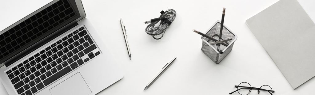 Graphic of laptop and pens