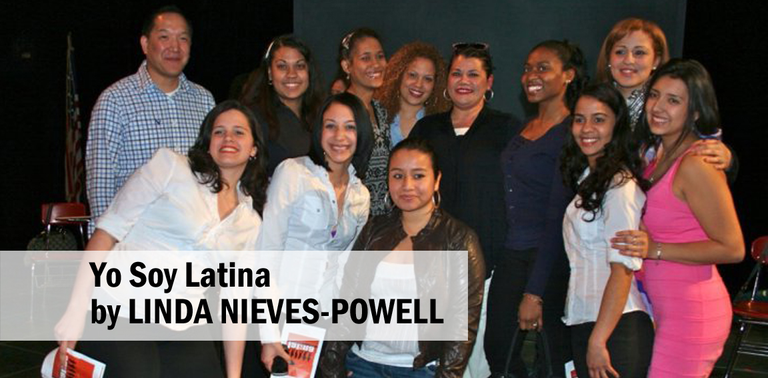 Students stand with playwright Linda Nieves-Powell.