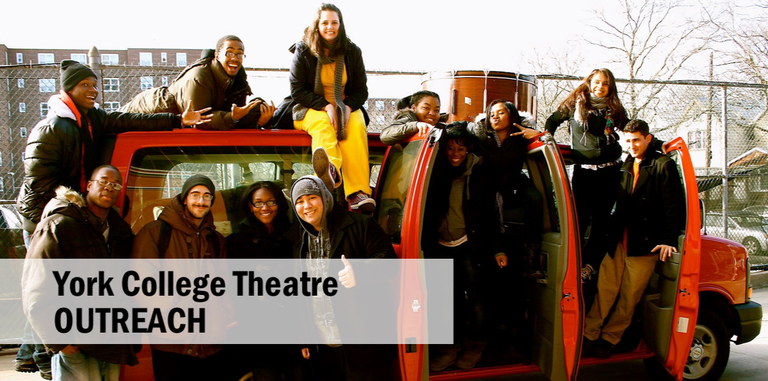 Student actors standing and sitting on top of York College red van.