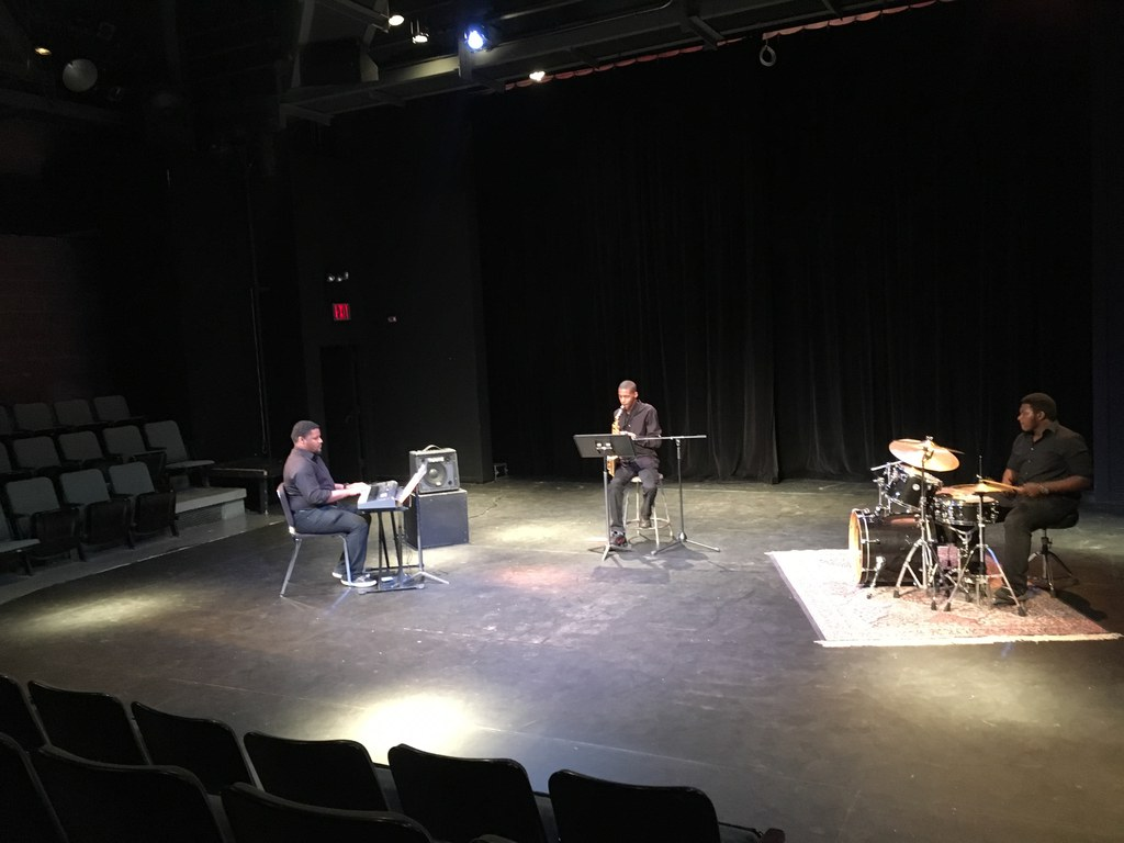 Students performing in the Performing Arts Center little theater.