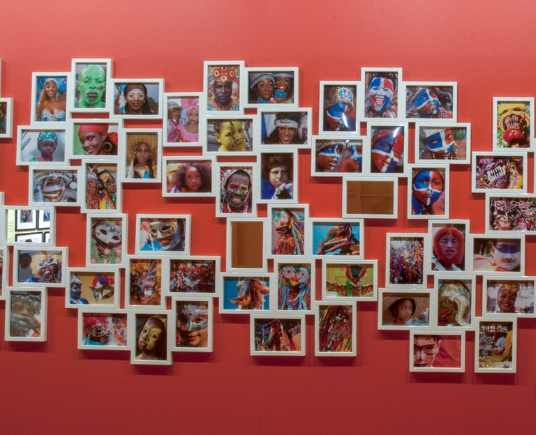 large number of small photographs as installed in a cluster in the gallery, centre portion